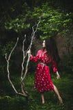 Woman in kimono in garden Stock Image