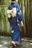 Woman in kimono and geta shoes Stock Images