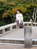 Woman in kimono in Japanese garden Stock Photos