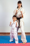 Woman in kimono posing with the child. Fighting position, active lifestyle, practicing fighting techniques Royalty Free Stock Photography