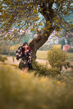 Woman in kimono under tree. A woman with long hair standing under a tree wearing a kimono Royalty Free Stock Photography