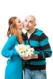 Woman kiss bold man Royalty Free Stock Photography