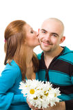 Woman kiss bold young happy man Stock Photo