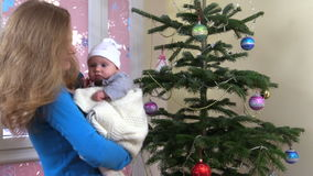 7d6c31b0d Cute Newborn Baby In Christmas Dress Fall Asleep On Mother Hands ...