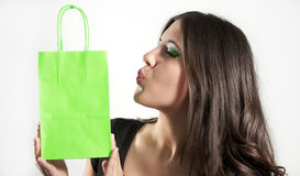 Woman kiss green shopper Stock Image