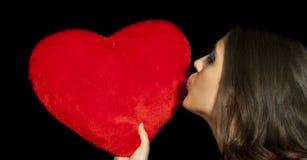 Woman kiss heart Stock Photo