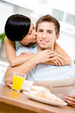 Woman kisses eating boyfriend Stock Image
