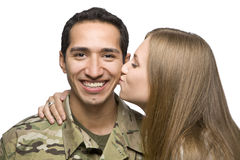 Woman Kisses Latino Serviceman on the Cheek Stock Photography