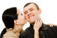 A woman kisses a man Stock Images