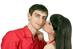 Woman kisses a man on the cheek Stock Image