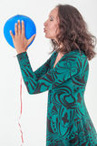 Woman kissing balloon Royalty Free Stock Photos