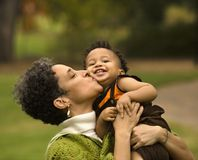 Woman kissing boy Royalty Free Stock Photography