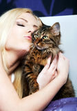 Woman kissing cat Stock Photography