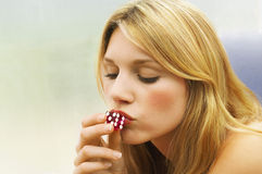 Woman Kissing Dice Royalty Free Stock Images