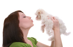 Woman Kissing Dog Royalty Free Stock Images