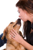 Woman kissing dog. Stock Images