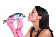 Woman kissing a fish Stock Photos