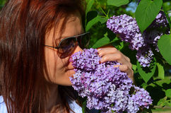 Woman kissing flower Stock Photo