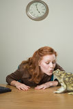 Woman kissing frog Stock Photo