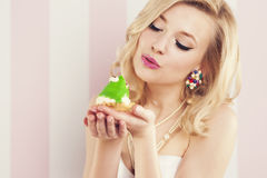 Woman kissing frog Stock Photography