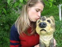 Woman kissing a funny dog Stock Photos