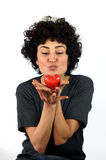 Woman kissing the heart Stock Photo