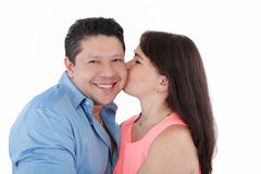 Woman kissing her Boyfriend Stock Photography