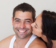 Woman kissing her Boyfriend stock image
