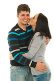 Woman kissing her boyfriend cheek Stock Photos