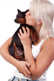 Woman kissing her dog Stock Images