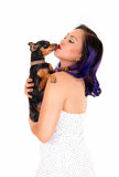 Woman kissing her dog. Stock Images