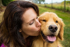 Woman kissing her dog Stock Photo