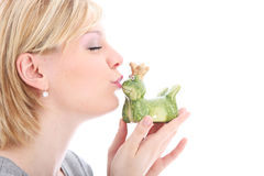 Woman kissing her frog prince Royalty Free Stock Images