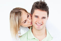 Woman kissing her happy boyfriend Royalty Free Stock Photo