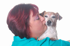 Dog kissing woman on white Stock Image