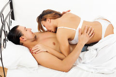 Woman kissing her man in chest Royalty Free Stock Photos