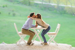 Woman Kissing Her Man Stock Photos