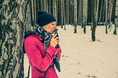 Woman kissing her mobile phone stock images