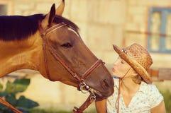 Woman kissing horse Royalty Free Stock Photos