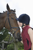 Woman Kissing Horse Stock Photo