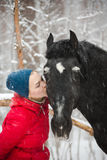 Woman kissing a horse Royalty Free Stock Image