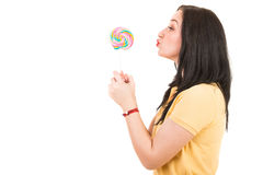 Woman kissing a lollipop Stock Images