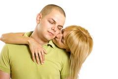 Woman kissing man Royalty Free Stock Image