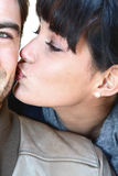 Woman kissing man Stock Photo