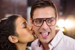 Woman kissing man on cheek Stock Photos