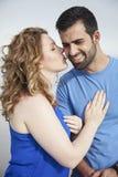 Woman kissing man  Stock Photography