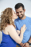 Woman kissing man Stock Images