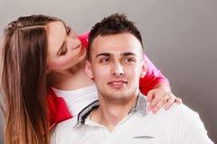 Woman kissing man. Happy couple. Love. Stock Photo