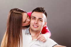 Woman kissing man. Happy couple. Love. Stock Photography