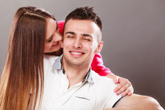 Woman kissing man. Happy couple. Love. Stock Photo